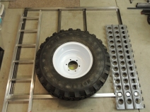 Fit Checked Tire Ladder and Sand Plates on Tire Mount Frame