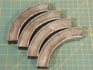 Welded Ladder Corners into Ring and Cut into 4 Pieces
