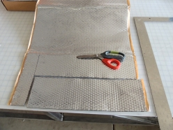 Applied Sound Deadening Mat to Sheet Metal Areas Behind Glove Box