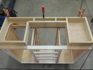 Cut, Fitted, and Sanded Wood for Under Countertop Riser