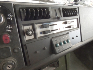 Fabricated, Painted, and Installed Plates to Secure Center Dash Panel