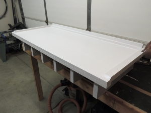 Applied first coat of paint to headboard-cubby assembly