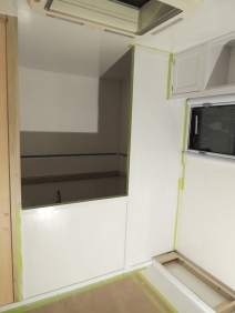 Applied second coat of paint on kitchen side of bedroom wall