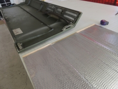 Applied sound deadening mat to underside of hood