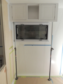 Bonded and installed upper kitchen cabinet