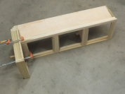 Bonded breaker-switch box assembly to passenger side overhead cabinet