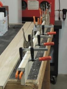 Bonded edge trim to bathroom wall