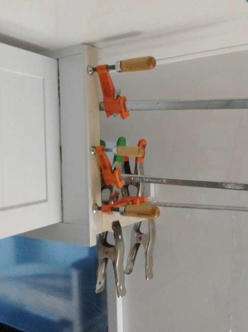 Bonded spacers to upper kitchen cabinet