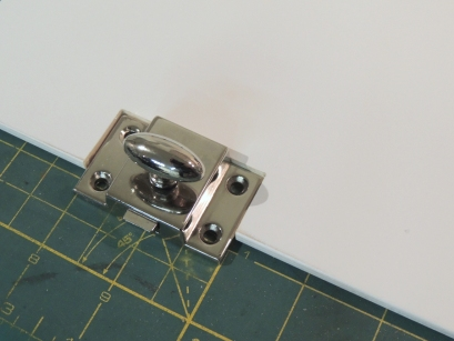 Cut latch opening in pantry door faces