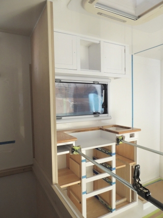 Dry fit, masked, prepped, bonded, screwed, and installed lower kitchen cabinet
