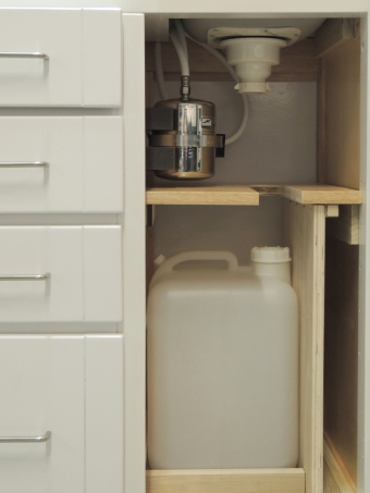 Fabricated and installed under sink shelf, cabinet partition, gray water tank mount