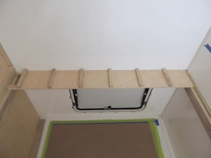 Fit checked headboard and cubby components in habitat