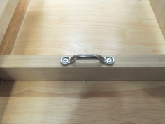 Installed footman's loops for securing cabinet contents