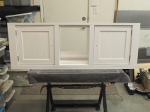 Installed hinges and doors on upper kitchen cabinet