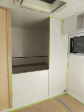 Masked and applied first coat of paint to forward side of driver side bed wall
