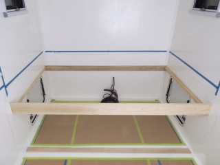 Prepped, bonded, and screwed bed support rails into habitat