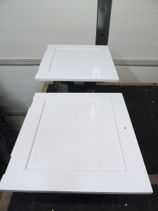 Sprayed top coat on upper kitchen cabinet and doors