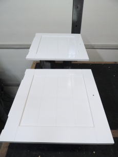 Sprayed top coat on upper kitchen cabinet and doors