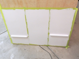 Started painting base board and back of lower kitchen cabinet