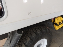 Drilled hole and bonded mount ring for ground power plug