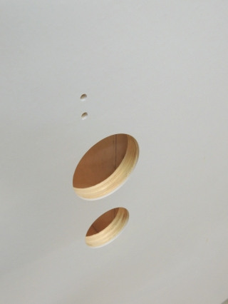 Drilled holes in shower area divider for shower fixture