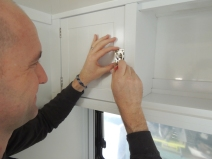 Installed latches on kitchen upper cabinets