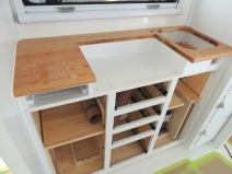 Kitchen lower cabinet installation sequence-heat shield for stove, stove, slide out cutting board, drawers, doors, sink