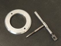 Machined mounting plate for ground power plug