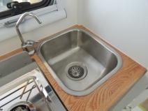 Silicone installed kitchen sink