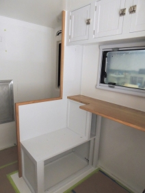 Test fit, masked, prepped, bonded, and screwed shower area divider and passenger side table