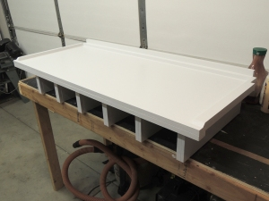 Appied final coat of paint to headboard-cubby assembly