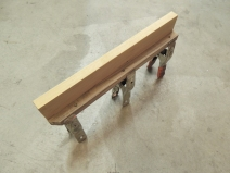 Fabricated passenger side bed wall table mount