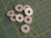 Fabricated spacer washers for ladder upper bracket