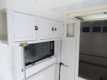Fit checked, prepped, bonded, and screwed passenger overhead cabinet