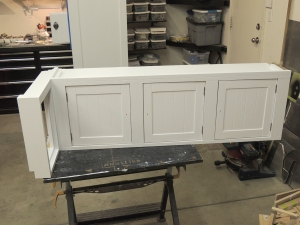 Installed doors in passenger side overhead cabinet