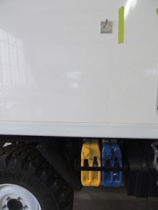 Located awning on exterior of truck and drilled awning mount holes