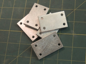 Machined spacers for cabinet door latches