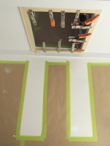 Cut opening for refrigerator slide in lower bed wall and installed trim around opening