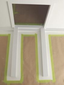 Painted refrigerator mount and trim around refrigerator opening