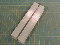 Cut aluminum channel for water jerry can support