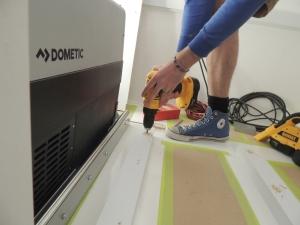 Installed refrigerator and slide in habitat