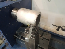 Machined aluminum sleeve to finish heater passthrough hole