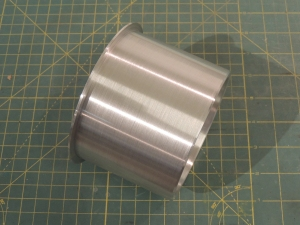 Machined aluminum sleeve to finish heater passthrough hole