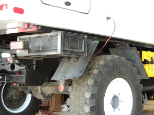 Rest fit aft under subframe storage