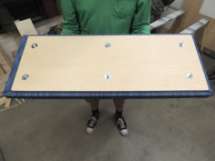 Upholstered and assembled seat bases