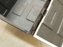 Added weather stripping to lids of under subframe storage boxes