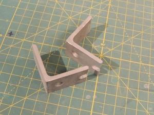 Fabricated under subframe storage box lock plates