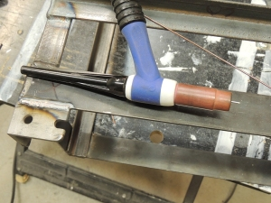 Welded lock plates to under subframe storage box mounts