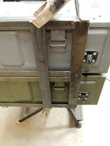 Cut metal for storage box lock mount