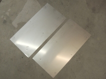 Fabricated stainless steel rear wheel shield plates